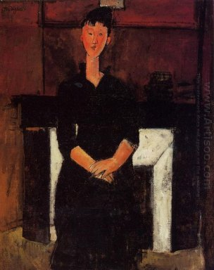 woman seated by a fireplace 1915
