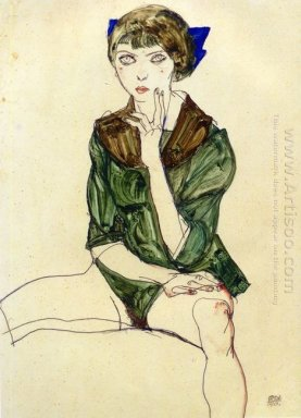 sitting woman in a green blouse 1913