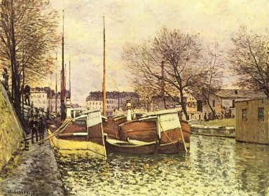 barges on the canal saint martin in paris 1870