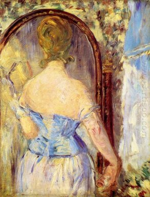 woman before a mirror 1877