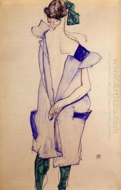 standing girl in a blue dress and green stockings back view 1913