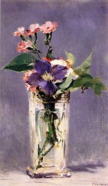 pinks and clematis in a crystal vase