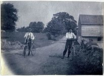 Benjamin Eakins and Samuel Murray with bicycles