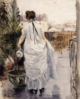 Young Woman Watering A Shrub