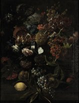 Various flowers in a glass vase with blue grapes, peaches and a