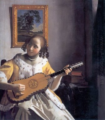 youg woman playing a guitar