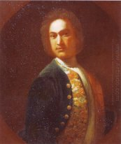 Portrait of young man in a green coat