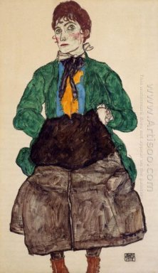 woman in a green blouse and muff 1915