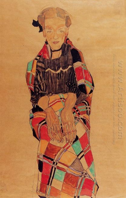 girl in black pinafore wrapped in plaid blanket 1910
