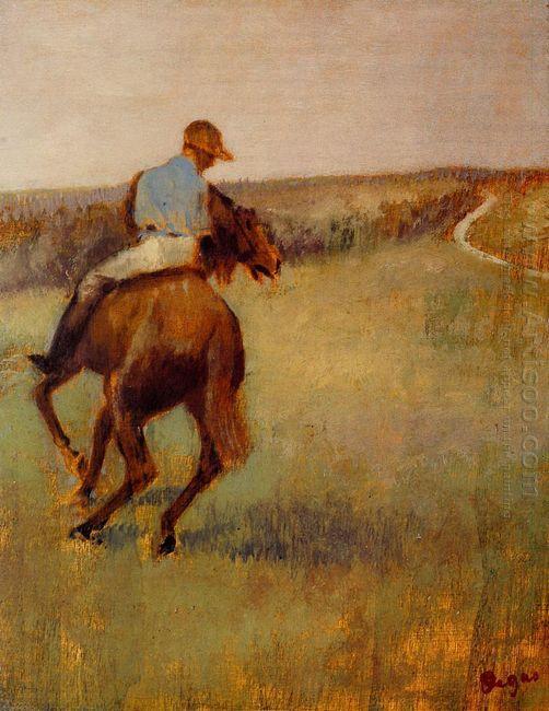 jockey in blue on a chestnut horse