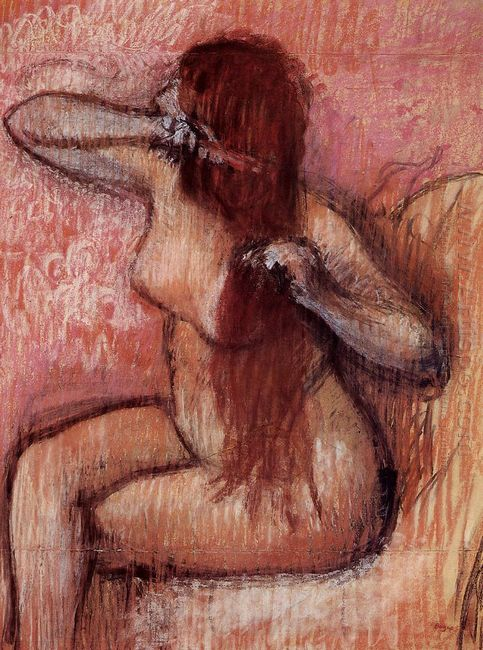 seated nude combing her hair