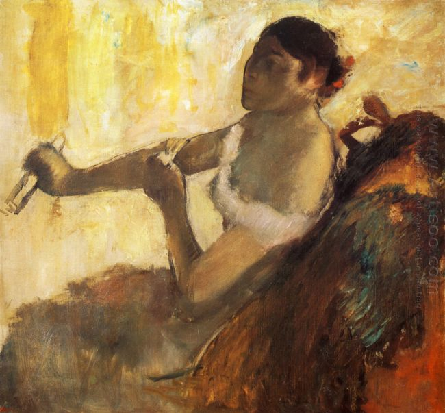 seated woman pulling her glove 1890