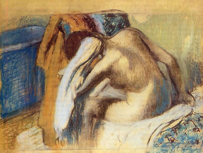 woman drying her hair