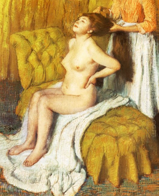 woman having her hair combed 1895