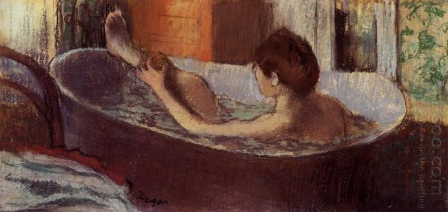 woman in a bath sponging her leg