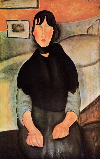 dark young woman seated by a bed 1918