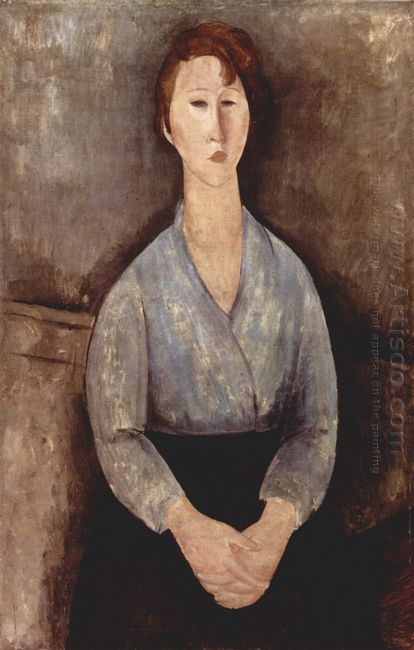 seated woman weared in blue blouse 1919