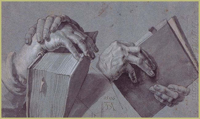 two hands holding a pair of books