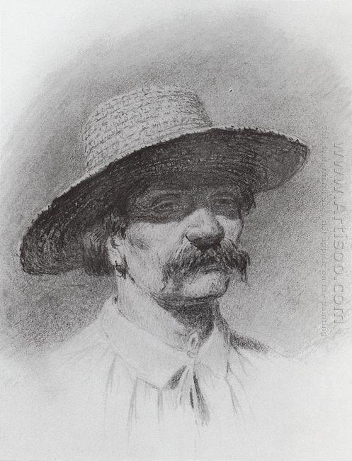men s head in a straw hat